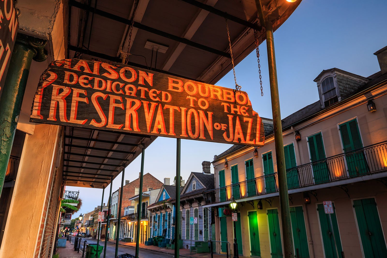 Sign on Bourbon St. in New Orleans for Maison Bourbon