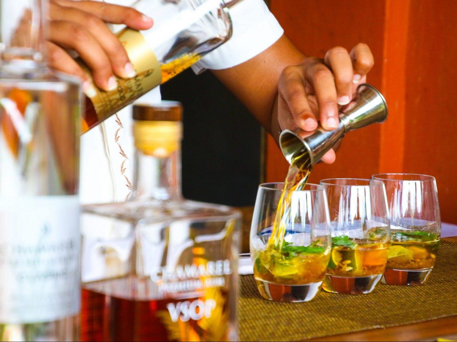 Hand Pouring Liquor Into Cocktail Glass